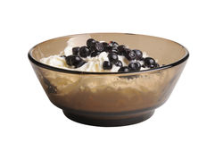Healthy breakfast. whipped cream yogurt and blueberries in a clear glass bowl. Stock Image