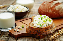 Healthy Breakfast with whole grain rye bread, cottage cheese and. Milk. the toning. selective focus stock image
