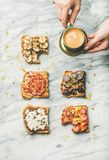 Healthy breakfast with wholegrain toasts , woman`s hands with coffee royalty free stock image
