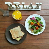 Healthy breakfast. Wholewheat bread ham cheese sandwich and colorful salad with orange juice Royalty Free Stock Photography