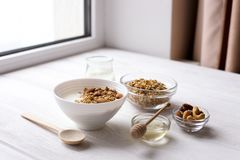 Healthy breakfast on window sill homemade granola with nuts. Healthy granola bars with nuts, seeds and dried fruits on white baking paper. Top view.Variety of Stock Image