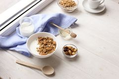 Healthy breakfast on window sill homemade granola with nuts. Healthy granola bars with nuts, seeds and dried fruits on white baking paper. Top view.Variety of Royalty Free Stock Images