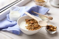 Healthy breakfast on window sill homemade granola with nuts. Healthy granola bars with nuts, seeds and dried fruits on white baking paper. Top view.Variety of Royalty Free Stock Photos