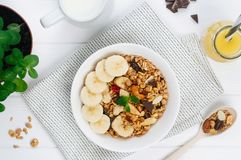 Free Healthy Breakfast With Chocolate Granola In The Bowl With Banana And Nuts On The Table Royalty Free Stock Photography - 139216057