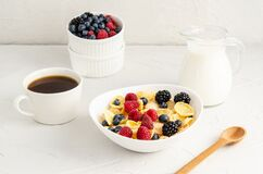 Free Healthy Breakfast With Cornflakes In A White Plate, Berries, Milk And Coffee On A White Background Stock Image - 173172901
