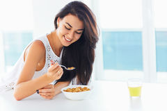 Healthy breakfast. Woman smiling and enjoying morning Stock Photography