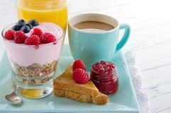 Healthy breakfast with yoghurt, berries, juice, toast and coffee stock photo