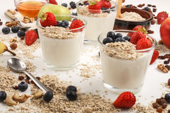 Healthy breakfast with yoghurt, fruit and oatmeal stock photography