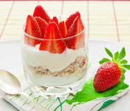 Healthy breakfast - yoghurt with granola and strawberries Royalty Free Stock Photo