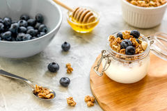 Healthy breakfast from yoghurt with muesli and berries on kitchen table Stock Photos