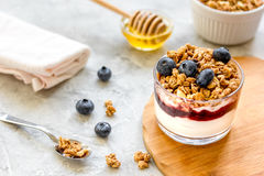 Healthy breakfast from yoghurt with muesli and berries on kitchen table Royalty Free Stock Image