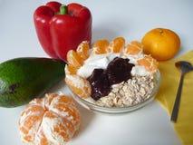 Healthy breakfast with yoghurt, oat flakes and mandarine Stock Photos