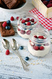 Healthy breakfast: yogurt based pudding with fresh berries in jar Royalty Free Stock Photography