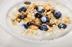 Healthy breakfast - yogurt with blueberries and muesli served in Stock Photos