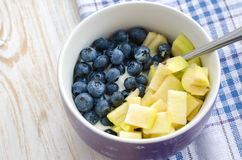 Healthy breakfast - yogurt with blueberry, oatmeal and apple.  royalty free stock image