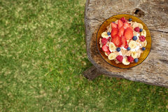 Healthy breakfast with yogurt,cereal and berries. Upper view of a healthy breakfast with yogurt, cornflakes and berries on a wooden table stock images