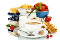 Healthy breakfast - yogurt, coffee, muesli and berries Royalty Free Stock Photo