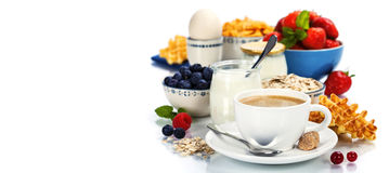 Healthy breakfast - yogurt, coffee, muesli and berries Stock Image