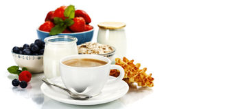 Healthy breakfast - yogurt, coffee, muesli and berries Stock Photo