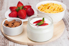 Healthy breakfast - yogurt, fresh strawberries and cornflakes. Horizontal Royalty Free Stock Images