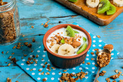 Healthy breakfast: yogurt with granola, banana and kiwi stock photo