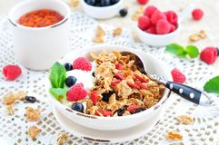Healthy breakfast, yogurt with granola and berries on the white table Royalty Free Stock Photography