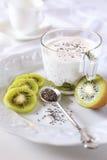 Healthy breakfast: yogurt, kiwi and Chia seeds Stock Photos