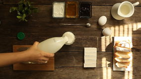 Healthy breakfast. yogurt, milk, eggs on rustic table. Fedelicious and healthy breakfast on a wooden table. top view stock video footage