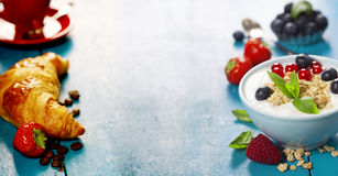 Healthy breakfast - yogurt with muesli and berries Stock Photos