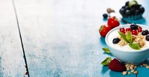 Healthy breakfast - yogurt with muesli and berries Stock Image