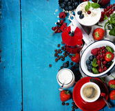 Healthy breakfast - yogurt with muesli and berries - health and Royalty Free Stock Images