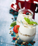 Healthy breakfast - yogurt with muesli and berries - health and Royalty Free Stock Image