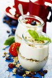 Healthy breakfast - yogurt with muesli and berries - health and Royalty Free Stock Photo