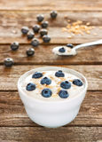 Healthy breakfast - yogurt with oat flakes and blueberries Stock Photo