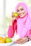 Healthy breakfast of young muslim woman Stock Images