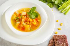 Healthy bright vegetable corn soup in a white plate with flax cr. Healthy bright vegetable corn soup in a white plate with crispy bread. Vegan Healthy Food royalty free stock photo