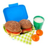 Healthy brown bread roll in blue lunch box with fruit and milk Stock Photo