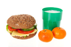 Healthy brown bread roll with fruit and milk Stock Image