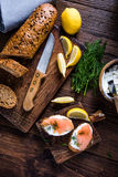 Healthy brunch smoked salmon with cottage cheese. On wooden rustic board Stock Photo