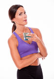 Healthy brunette with a glass of water Stock Image