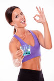 Healthy brunette offering glass of water Stock Images
