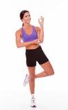 Healthy brunette on one leg posing Royalty Free Stock Photo
