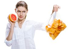Healthy brunettes against the chips - isolated on white background Stock Image