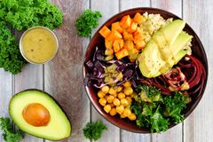 Healthy Buddha bowl on wood background, overhead scene royalty free stock image