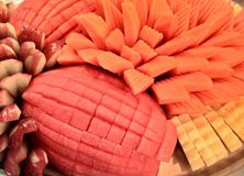 Healthy buffet fruit food party. Sweet reception watermelon pineapple papaya cantaloupe pineapple delicious cuisine tasty tongs selection fruit catered cater Royalty Free Stock Photos