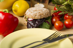 Healthy Burger Beside Fresh Ingredients and Plate Stock Photography