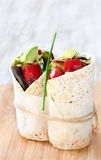 Healthy burrito wraps with roasted vegetables. Healthy vegetarian vegan tortilla wraps with roasted vegetables like aubergine eggplant, red bell peppers, avocado stock photos