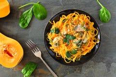 Healthy butternut squash spirilized noodle dish, above scene on dark background Stock Photo