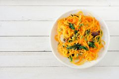Healthy butternut squash spirilized noodle dish, above on white wood Stock Photos