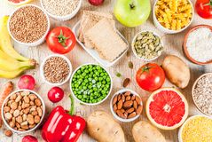 Healthy carbohydrates ingredients. Diet food background concept, healthy carbohydrates carbs products - fruits, vegetables, cereals, nuts, beans, light concrete royalty free stock photography